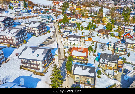 Aerial view of the living neighborhood of St Gilden from the cable car, riding to the top of Zwolferhorn mountain, Salzkammergut, Austria - Stock Photo