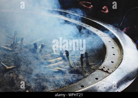 High Angle View Of Smoke Emitting From Incense At Temple - Stock Photo