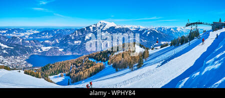 The view from the top of snowy Zwolferhorn mount on valley of Wolfgangsee lake, cable car and Alpine landscape of Salzkammergut, St Gilgen, Austria - Stock Photo