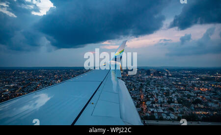 New York USA. June 3, 2019. Alaska airlines plane approaching Newark airport in the evening, view out of an airplane window. - Stock Photo