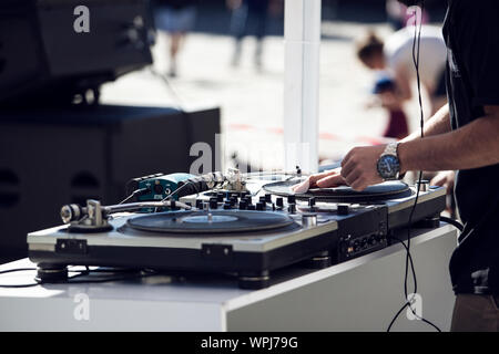 Dj playing and mixing music on outdoor at party festival. Outdoor, sunny day - Stock Photo