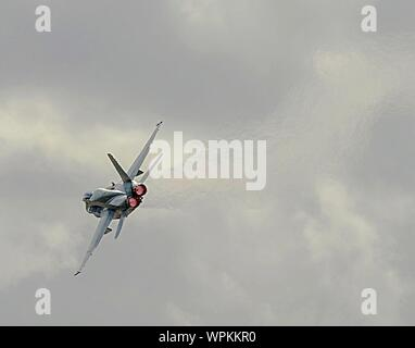 Low Angle View Of Fighter Plane Against Sky - Stock Photo