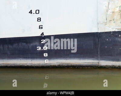 Waterline numbers or draft marks on the hull of a minesweeper to show the draught of the ship in various loading and water conditions. - Stock Photo