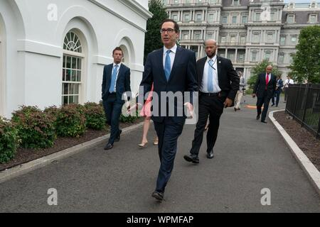 Washington, United States Of America. 09th Sep, 2019. United States Secretary of the Treasury Steven T. Mnunchin walks toward the White House following a television interview in Washington, DC, U.S. on September 9, 2019. Credit: Stefani Reynolds/CNP | usage worldwide Credit: dpa/Alamy Live News - Stock Photo