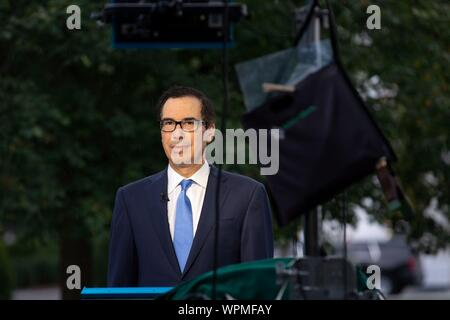 Washington, United States Of America. 09th Sep, 2019. United States Secretary of the Treasury Steven T. Mnunchin prepares for a television interview outside the White House in Washington, DC, U.S. on September 9, 2019. Credit: Stefani Reynolds/CNP | usage worldwide Credit: dpa/Alamy Live News - Stock Photo
