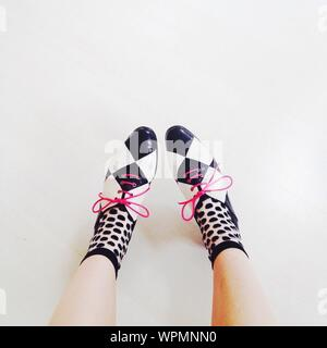 Low Section Of Woman In Shoes And Socks - Stock Photo