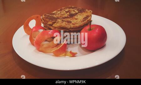Pancakes And Apple Served In Plate - Stock Photo