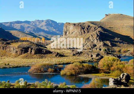 Scenic View Of Lake And Mountains Against Clear Blue Sky - Stock Photo