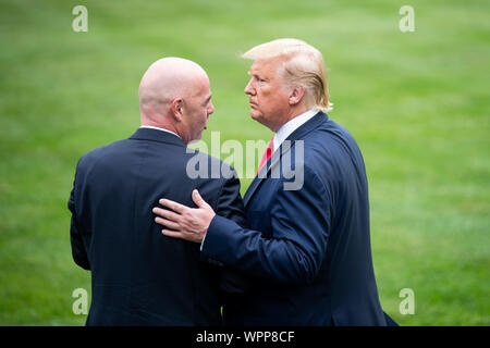 Washington DC, USA. 09th Sep, 2019. President Donald Trump (R) talks to FIFA President Gianni Infantino as Trump departs the White House for a rally in North Carolina, in Washington, DC on Monday, September 9, 2019. Photo by Kevin Dietsch/UPI Credit: UPI/Alamy Live News - Stock Photo