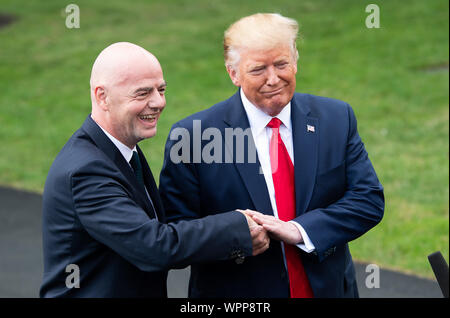 Washington DC, USA. 09th Sep, 2019. President Donald Trump (R) and FIFA President Gianni Infantino speak to the media as Trump departs the White House for a rally in North Carolina, in Washington, DC on Monday, September 9, 2019. Photo by Kevin Dietsch/UPI Credit: UPI/Alamy Live News - Stock Photo