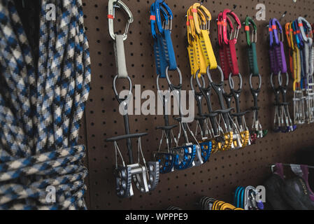 Rock climbing and mountaineering equipment stored on the wall - Stock Photo