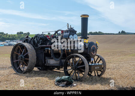 Blandford Forum.Dorset.United Kingdom.August 24th 2019.A vintage traction engine used for pulling a plough is on display at The Great Dorset Steam Fai - Stock Photo