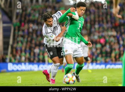 Belfast, UK. 09th Sep, 2019. Belfast, Grossbritannien. 09th Sep, 2019. firo: 09.09.2019 Football: Soccer EURO, Euro Qualification: Northern Ireland - Germany duels, Germany forward Serge Gnabry (20) tussles with Northern Ireland defender Jamal Lewis (3) | usage worldwide Credit: dpa/Alamy Live News - Stock Photo