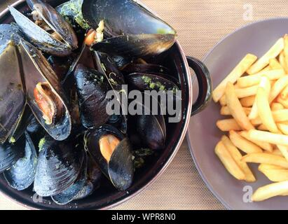 mussels marinara with fries - Stock Photo