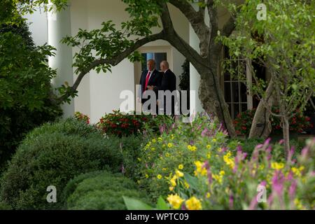 Washington, United States Of America. 09th Sep, 2019. United States President Donald J. Trump and FIFA President Gianni Infantino leave the Oval Office of the White House in Washington, DC, U.S. on September 9, 2019. Credit: Stefani Reynolds/CNP | usage worldwide Credit: dpa/Alamy Live News - Stock Photo