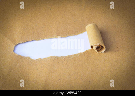 Close-up Of Torn Paper On Table - Stock Photo