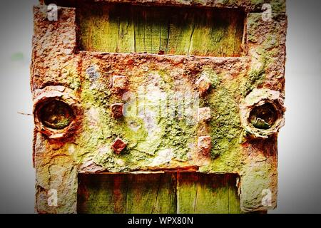 Rusty Bolt And Nut On Weathered Wood - Stock Photo