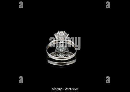 Close-up Of Ring Over Black Background - Stock Photo
