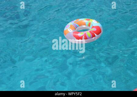 Inner Tube Floating On Water - Stock Photo