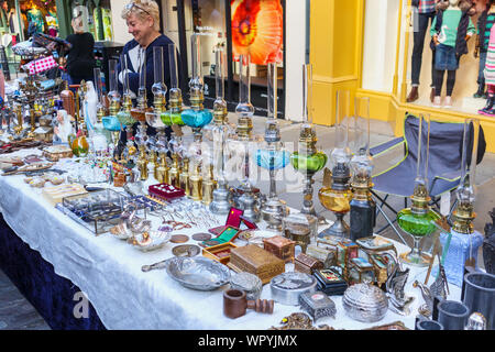 Antiques displayed for sale on a stall in the Guildford Antique & Brocante Street Market, High Street, Guildford, Surrey, southeast England, UK - Stock Photo
