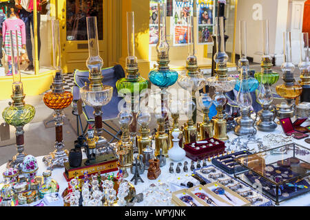 Antiques displayed for sale on a market stall in the Guildford Antique & Brocante Street Market, High Street, Guildford, Surrey, southeast England, UK - Stock Photo