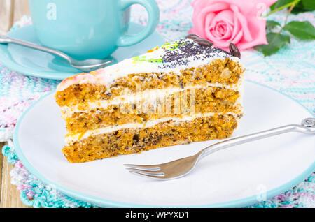 Slice of carrot sponge cake with cream - Stock Photo