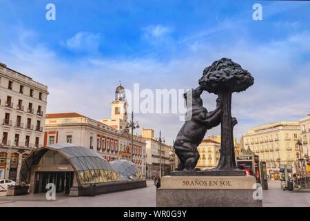 Madrid, Spain - April 14, 2019: Madrid Spain city skyline at Puerta del Sol square with statue of the bear and the strawberry tree - Stock Photo