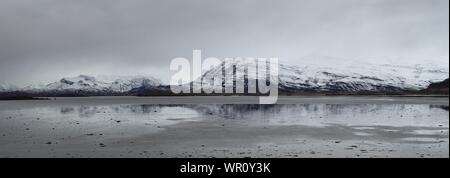 Scenic View Of Lake Against Sky During Winter - Stock Photo