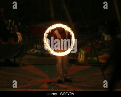 Man Spinning Fire In Circus At Night - Stock Photo