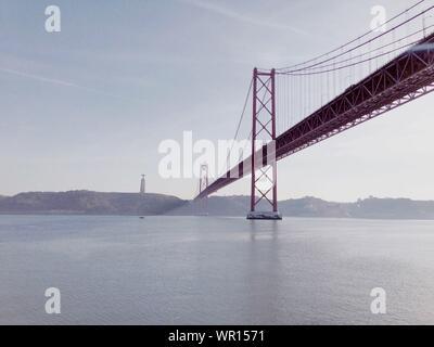 25 De Abril Bridge Over Sea Against Sky - Stock Photo