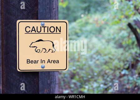 Fintry, British Columbia, Canada - September 9, 2019: sign warning people a bear has been spotted near hiking trails in Fintry Provincial Park - Stock Photo