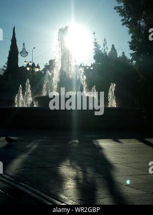 Fountain At Park Against Sky On Sunny Day - Stock Photo