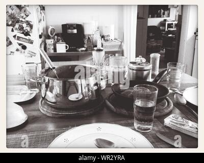 Utensils And Plates With Glasses On Table