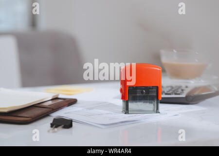 Closed up and soft focus on pen laying on paperwork with calculator for summary income or profit at office desk. - Stock Photo