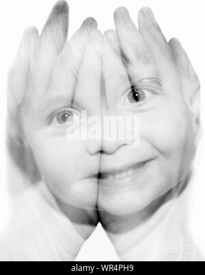 Double Exposure Image Of Happy Baby Boy And Hands Cupped Against White Background - Stock Photo