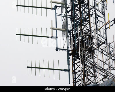 Low Angle View Of Communications Tower Against Clear Sky - Stock Photo