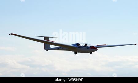 Low Angle View Of Fighter Plane Flying Against Sky - Stock Photo