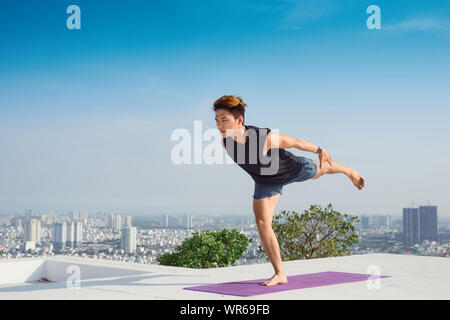 Man practicing advanced yoga. A series of yoga poses. lifestyle concept. - Stock Photo
