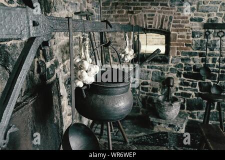 Kitchen Utensils Hanging In Room - Stock Photo