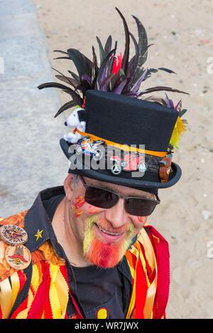Colourful hat of Morris dancer, member of Ragged Phoenix Morris, at Swanage Folk Festival, Swanage, Dorset UK in September - Stock Photo