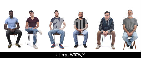group of mixed man sitting on chair on white background - Stock Photo