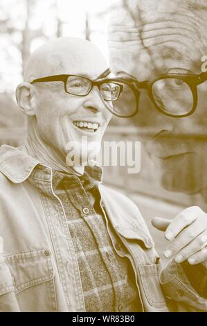 Digital Composite Image Of Smiling Senior Man - Stock Photo