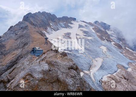 Marmolada glacier and Rifugio Serauta as seen from the via ferrata route called Eterna (Brigata di Cadore), in Summer. - Stock Photo