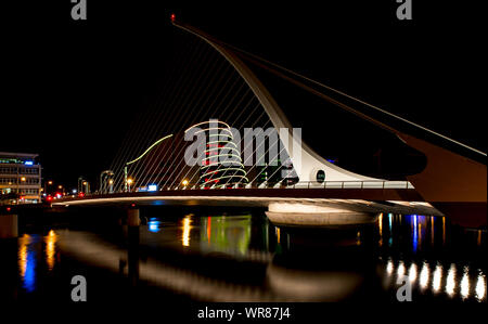 Samuel Beckett Bridge Over River At Night - Stock Photo