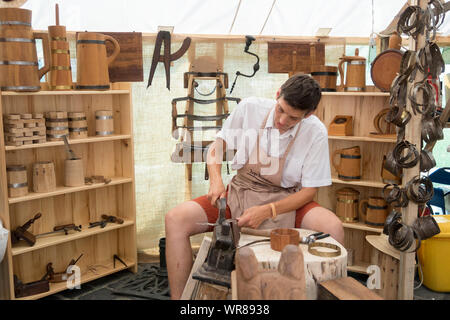 Budapest, Hungary - Aug 20, 2019: Traditional woodworker making wooden cups at the Festival of Folk Arts in the Buda Castle, Budapest Hungary. - Stock Photo