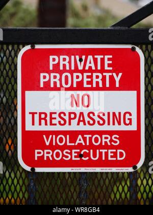 No Trespassing Sign On Fence - Stock Photo