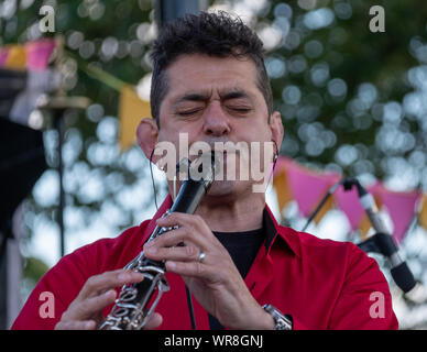Talented clarinetist Merlin Shepherd playing at an annual concert of Jewish Klezmer music in Regent`s Park in London UK. - Stock Photo