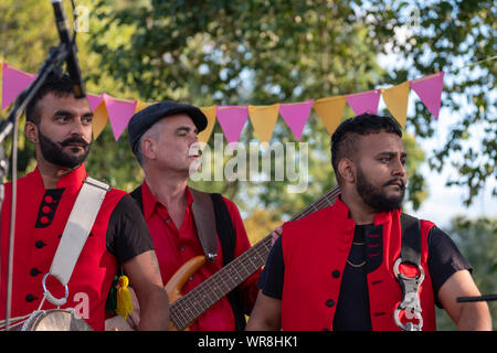 Drummers from the Dhol Foundation playing the drums at an annual concert of Jewish Klezmer music in Regent`s Park in London UK. - Stock Photo