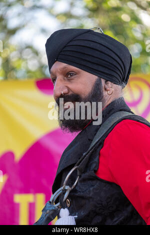 Drummer Jonny Kalsi from the Dhol Foundation playing at an annual concert of Jewish Klezmer music in Regent`s Park in London UK. - Stock Photo