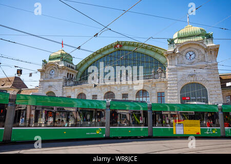 Railroad Station and Tram in a Sunny Day in Basel, Switzerland. - Stock Photo